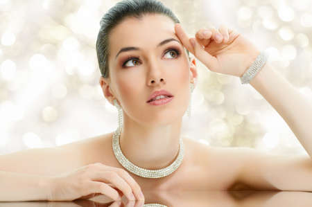 portrait of beautiful woman with jewelry photo