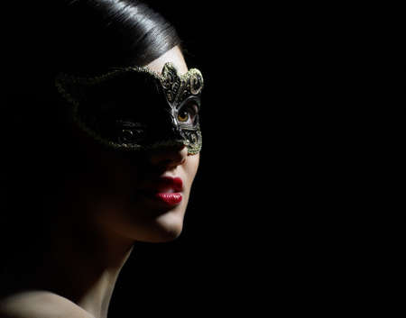 masked woman: cute girl in masquerade mask Stock Photo