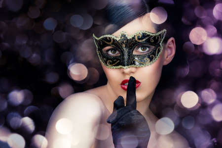 beauty mask: cute girl in masquerade mask Stock Photo