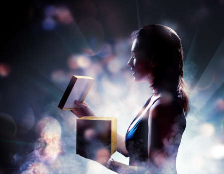 magic box: silhouette of a woman on a background of lights