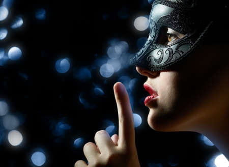 black mask: cute girl in masquerade mask Stock Photo
