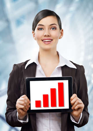 computer worker: a woman holding a tablet pc