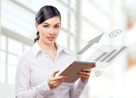 a woman holding a tablet pc Stock Photo - 12073696