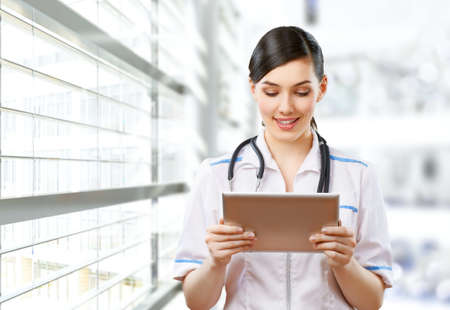 doctor tablet: a woman holding a tablet pc
