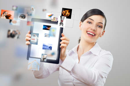 a woman holding a tablet pc photo
