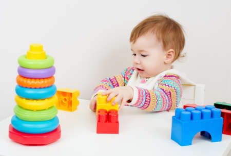 little child playing with with toys photo