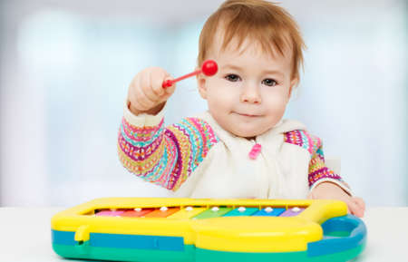music education: little child playing with with toys Stock Photo