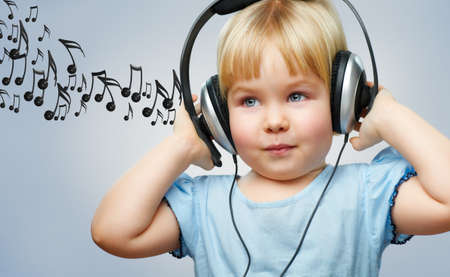 a little girl listening to music photo