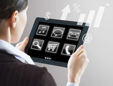 a woman holding a tablet pc Stock Photo - 12305639