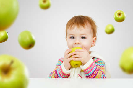 eating fruit: a beautiful child enjoying life