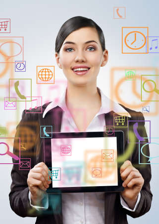 a woman holding a tablet pc Stock Photo - 12305676