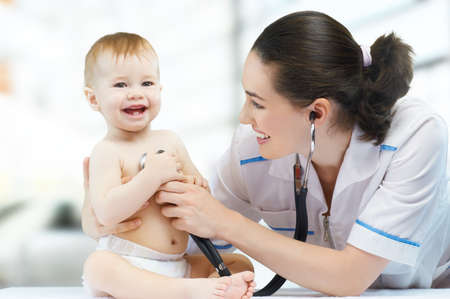 urgent care: a doctor holding a baby on the hands Stock Photo