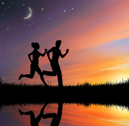 fitness motivation: running people on the sky background