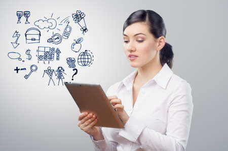 a woman holding a tablet pc Stock Photo - 12878716