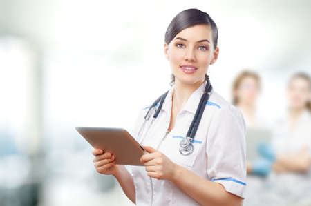 healthcare workers: a woman holding a tablet pc