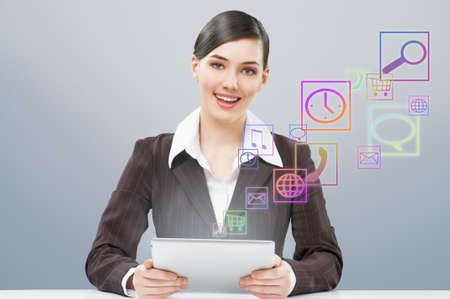a woman holding a tablet pc Stock Photo - 12980865
