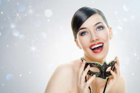 mysterious woman: cute girl in masquerade mask Stock Photo