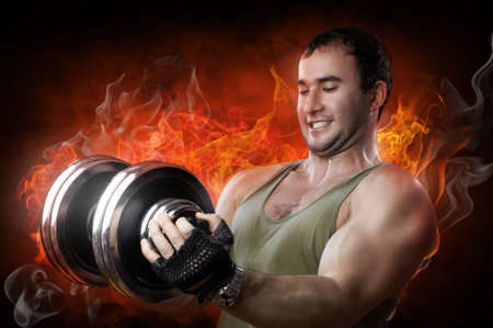 powerful muscular man lifting weights  photo