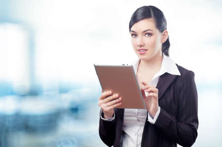 a woman holding a tablet pc Stock Photo - 13184338