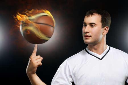 man spinning basketball on finger photo