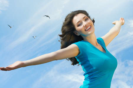 only one woman: A beautiful girl enjoying summer sun Stock Photo