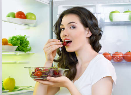 a hungry girl opens the fridge Stock Photo - 14284051