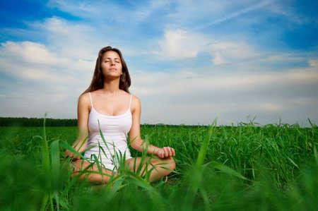 beautiful girl relaxing in a field photo