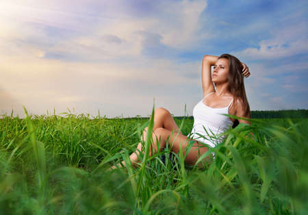 beautiful girl relaxing in a field photo