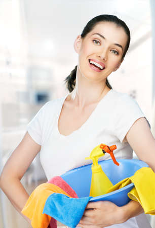 Woman with a pack of detergents photo