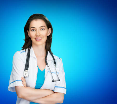 successful doctor on the blue background photo