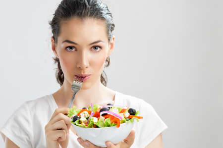 salad fork: A beautiful girl eating healthy food