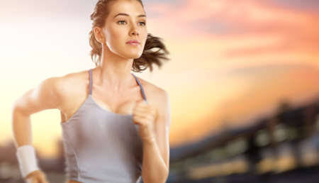 girl in sport on the sunset background photo