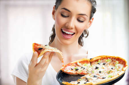 only one woman: Girl eating a delicious pizza