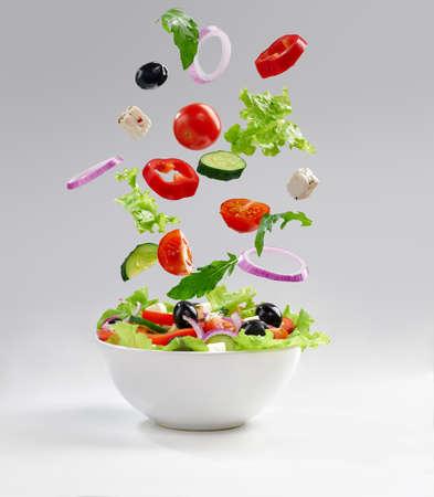 Fresh vegetarian salad on the plate photo