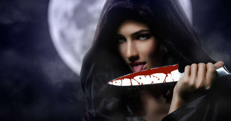 female vampire: Young beautiful witch. Halloween day