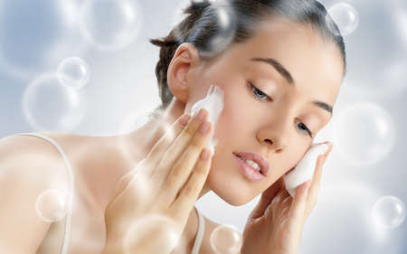 beautiful girl washes his face Stock Photo - 15483215