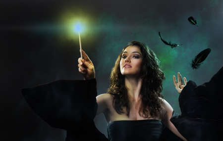 magic wand: Young beautiful witch. Halloween day