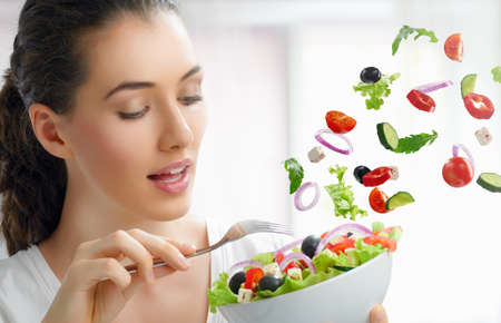 nutrient: A beautiful girl eating healthy food