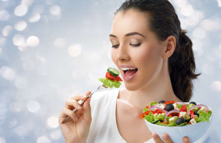 beautiful salad: A beautiful girl eating healthy food