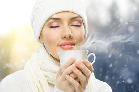 girl drinking hot coffee photo
