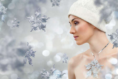 beautiful girl on the background of snow-flakes photo