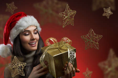 the girl in a hat with a gift Stock Photo - 16304812