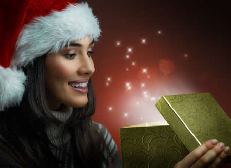 opening gift: the girl in a hat with a gift
