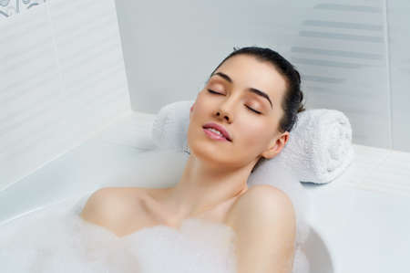lying in bathtub: beautiful girl lying in the bathroom