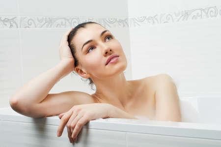 lying in bathtub: beautiful girl lying in the bathroom