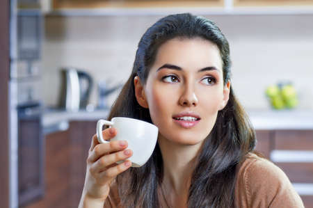 healthy life: a beauty girl on the kitchen background