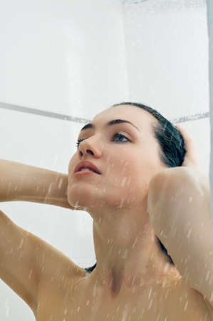 wet hair: a beautiful girl standing at the shower