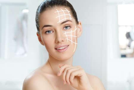 forehead: beauty woman on the bathroom background