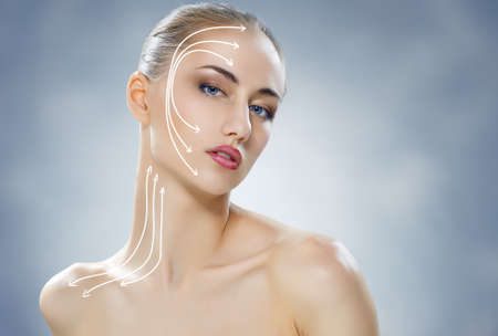 facial treatment: beauty woman on the blue background Stock Photo