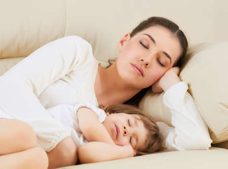 baby sleep: happy mother holding her child